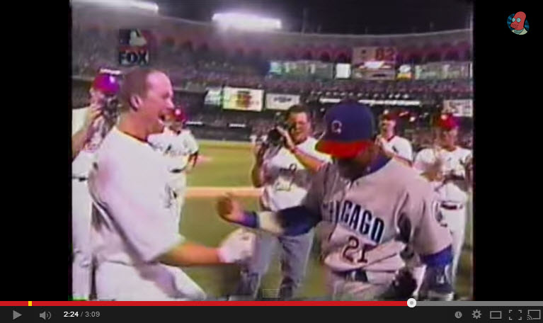 Mark McGwire breaks Roger Maris record. He is congratulated by home run rival Sammy Sosa.